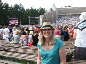 Alissa at the Latvian Song Festival in front of 15,000 person choir